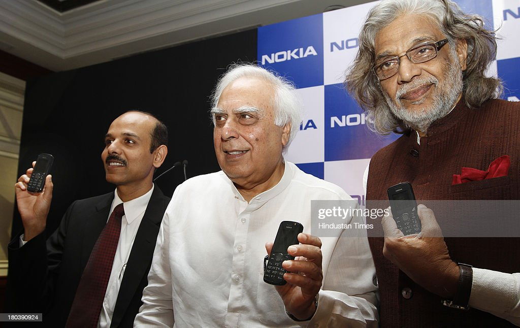 P Balaji, Managing Director of Nokia, Union Minister for Communication and IT Kapil Sibal and Film maker Muzaffar Ali during launch of refreshed version of Nokia 114 with Urdu language support on September 12, 2013 in New Delhi, India. Nokia becomes first mobile company in India to support regional language content in 11 Indian languages that include Hindi, Malayalam, Tamil, Telugu, Kannada, Gujarati, Bengali, Oriya, Assamese, Punjabi, and Marathi.