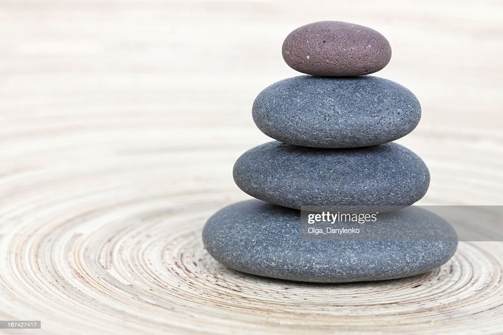 Balancing of pebbles on wooden background : Stock Photo