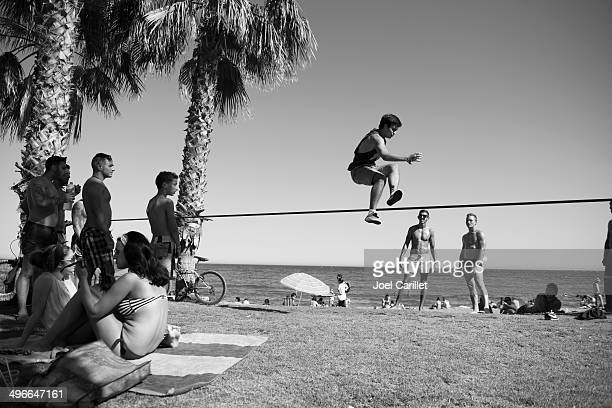 Balancing on slackline at the beach in Malaga, Spain