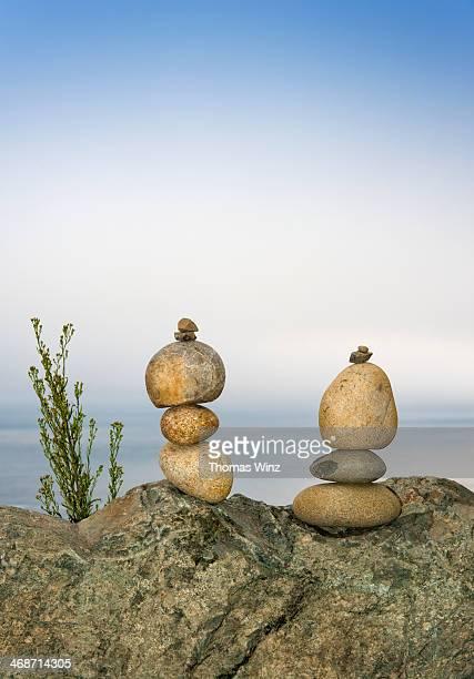 Balancing stones along California coastline