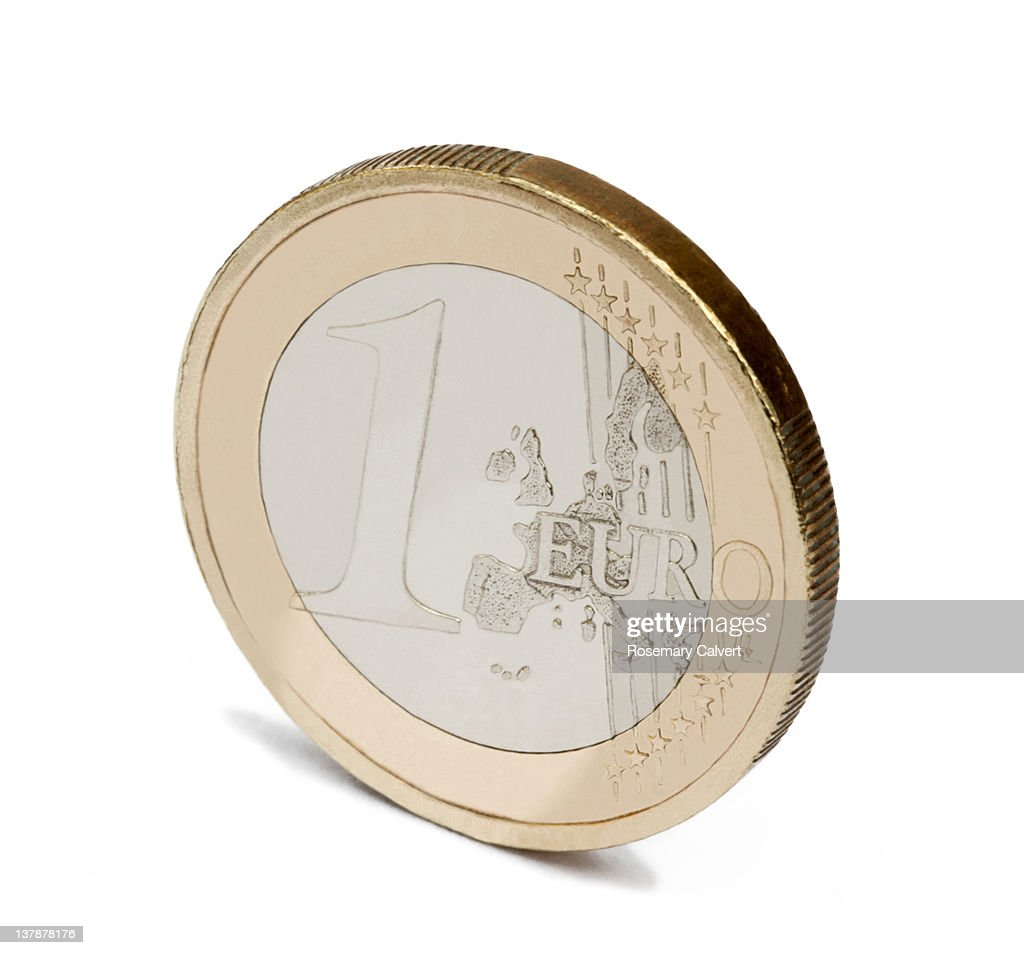 Balancing the euro, one coin standing on its edge.