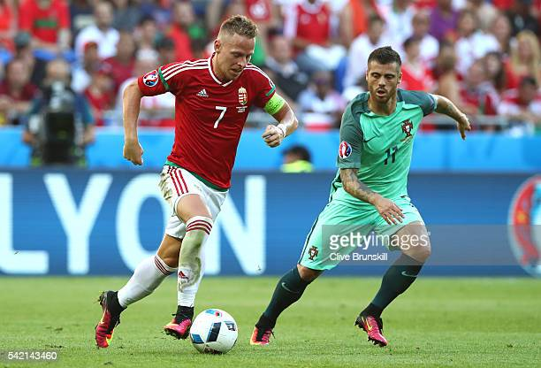 Balazs Dzsudzsak of Hungary and Joao Moutinho of Portugal compete for the ball during the UEFA EURO 2016 Group F match between Hungary and Portugal...