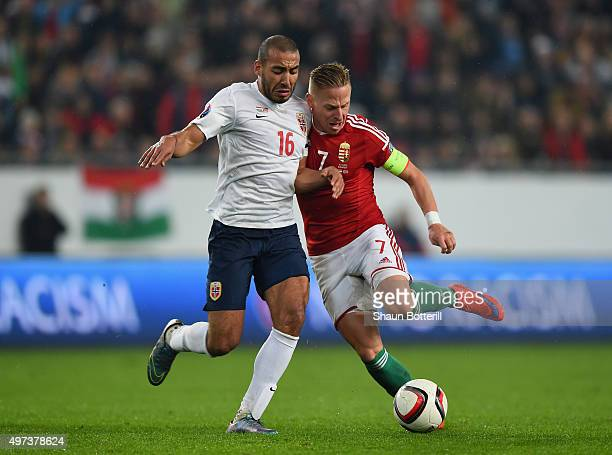 Balazs Dzsudzsak of Hungary is challenged by Haitam Aleesami of Norway during the UEFA EURO 2016 qualifier playoff second leg match between Hungary...