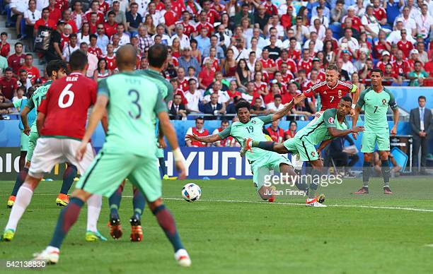 Balazs Dzsudzsak of Hungary scores his team's third goal during the UEFA EURO 2016 Group F match between Hungary and Portugal at Stade des Lumieres...