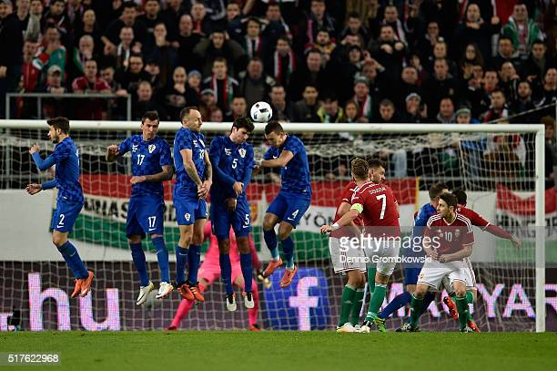 Balazs Dzsudzsak of Hungary scores their first goal during the International Friendly match between Hungary and Croatia at Groupama Arena on March 26...