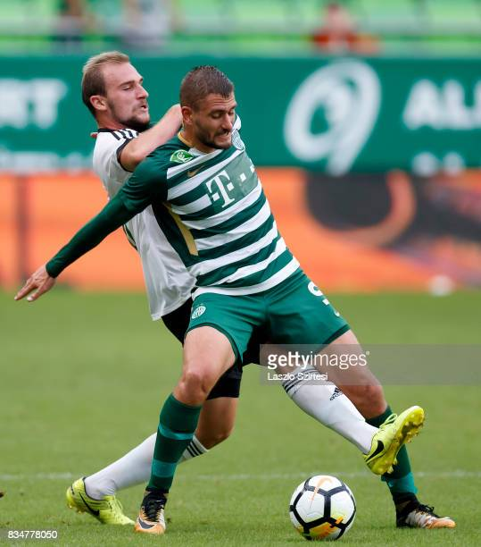 Balazs Lovrencsics of Ferencvarosi TC fights for the ball with Andras Jancso of Swietelsky Haladas during the Hungarian OTP Bank Liga match between...