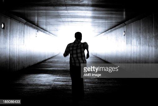 Balck and white image of man's silhouette running