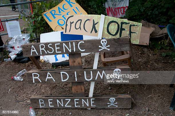 Balcombe West Sussex Site of Cuadrilla drilling Demonstration against fracking At the site entrance signs saying Frack off Arsenic Radium Benzene