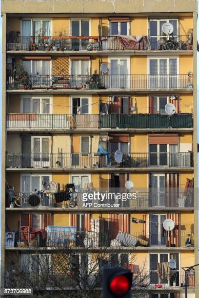 Balconies of apartments buildings are pictured at the Chene Pointu housing estate on November 13 in ClichysousBois northern Paris / AFP PHOTO /...