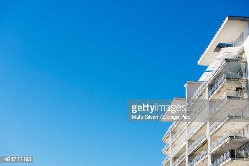 Balconies On A Building Against A Blue Sky