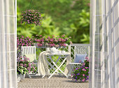 Balcony, white furniture and flowers