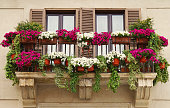 Beautiful Balcony Decorated with Flower Pots during Springtime