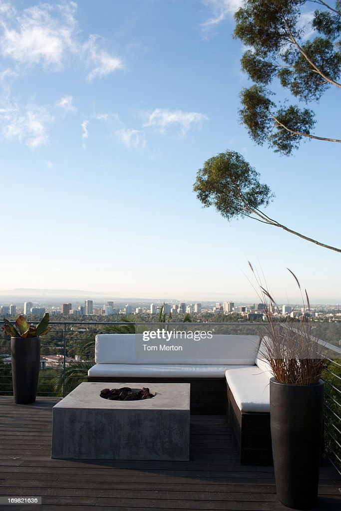 Balcony seating area overlooking cityscape : Stock Photo