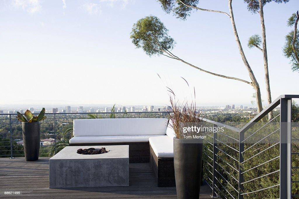 Balcony seating area overlooking cityscape : Stock Photo
