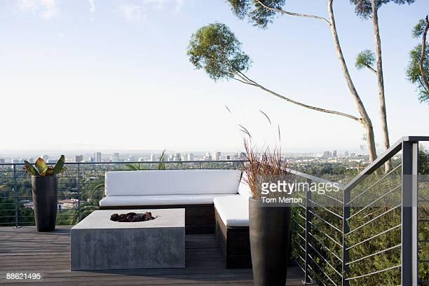 Balcony seating area overlooking cityscape