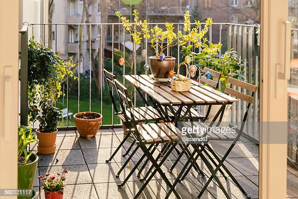 Balcony with table, chairs and Easter decoration