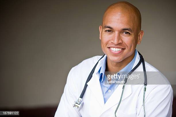Bald African Asian descent young doctor