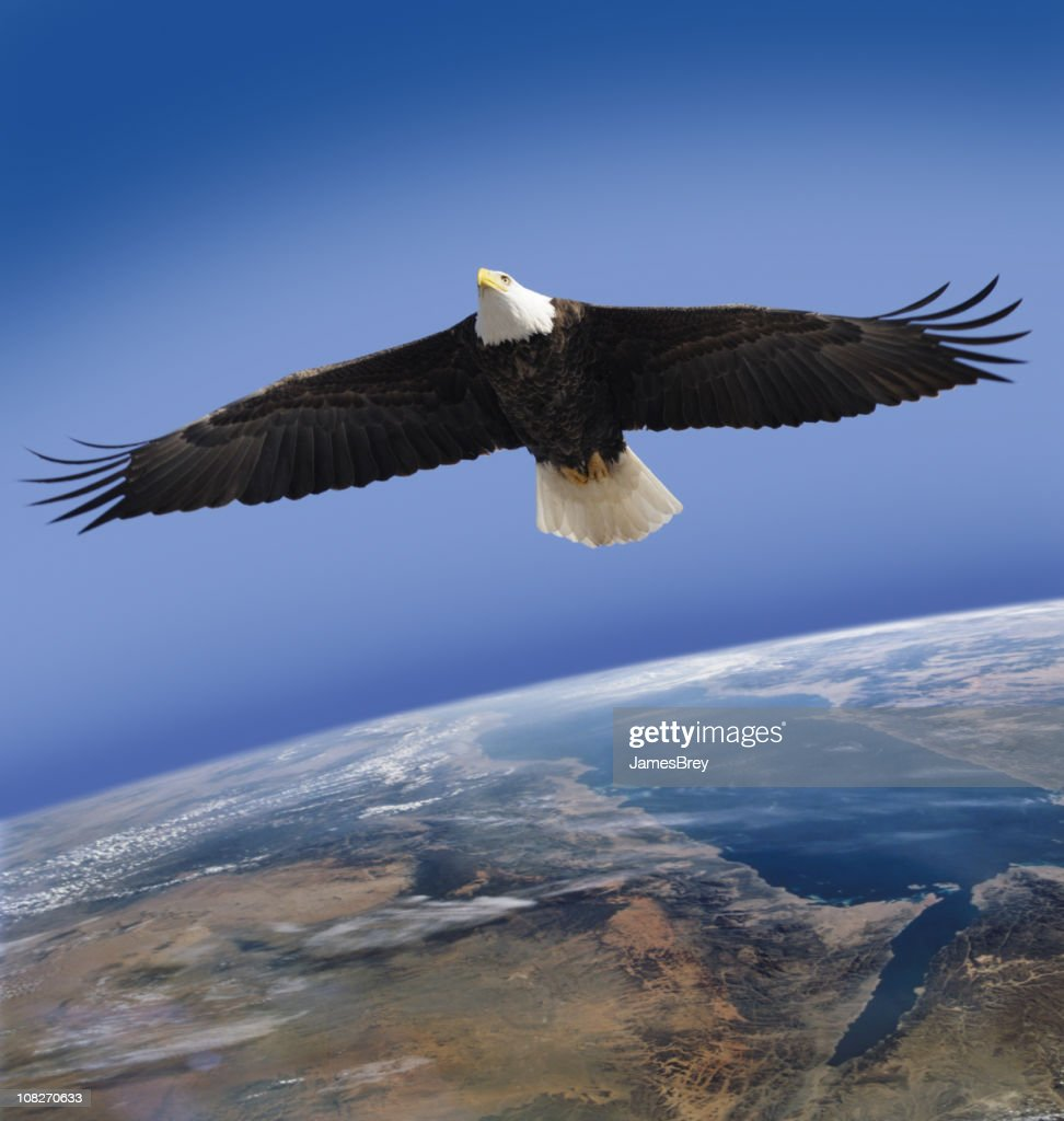 Bald Eagle Flying in Space Over Planet Earth