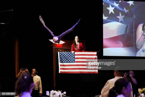 A bald eagle named Challenger flies as American Eagle Foundation Director of Operations Laura Sterbens looks on during a rehearsal for Muhammad Ali's...