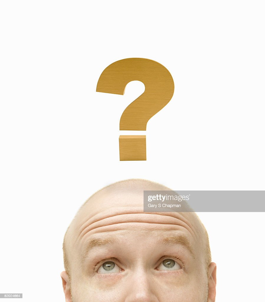 Bald head and question mark : Stock Photo