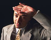 A bald headed businessman putting hand on forehead, Side View