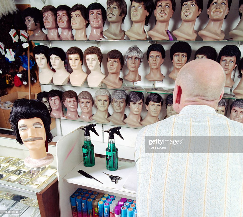 Bald Man at Wig Shop Counter
