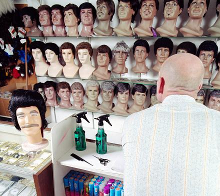Bald Man at Wig Shop Counter
