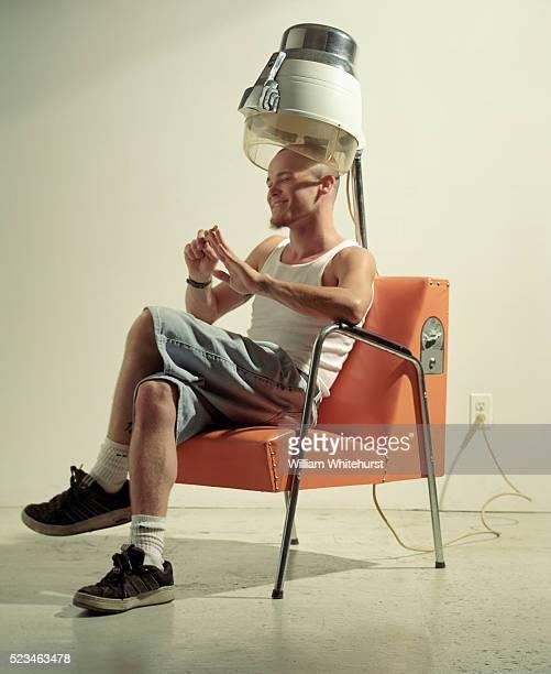 Bald Man Sitting Under Hair Dryer