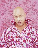 Bald man wearing patterned shirt, portrait