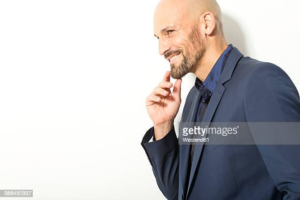 Bald man with beard wearing blue shirt and jacket