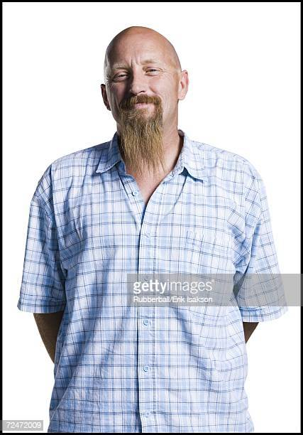 Bald middle aged man with a long goatee