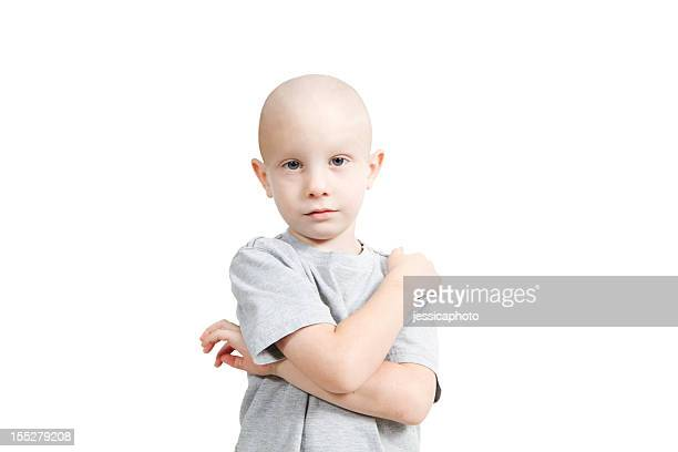 Bald small child in white shirt on white background