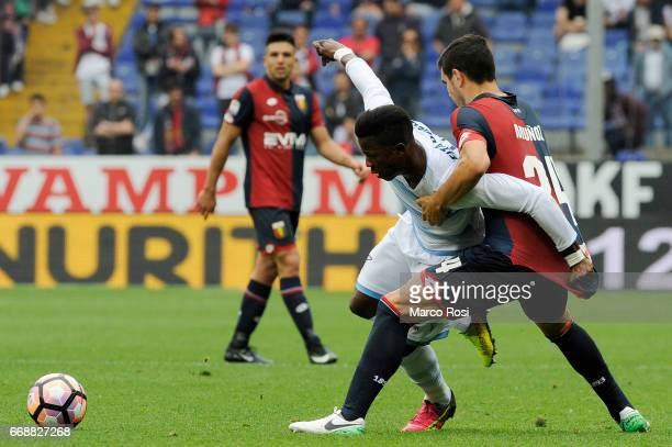 Balde Diao Keita of SS Lazio battles with Ezequiel Munoz of Genoa CFC during the Serie A match between Genoa CFC and SS Lazio at Stadio Luigi...