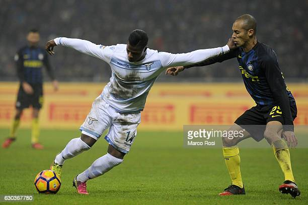 Balde Diao Keita of SS Lazio compete for the ball with Joao Mirada of FC Internazionale during the Serie A match between FC Internazionale and SS...