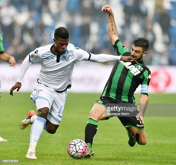 Balde Keita of Lazio and Francesco Magnanelli of Sassuolo in action during the Serie A match between US Sassuolo Calcio and SS Lazio at Mapei Stadium...