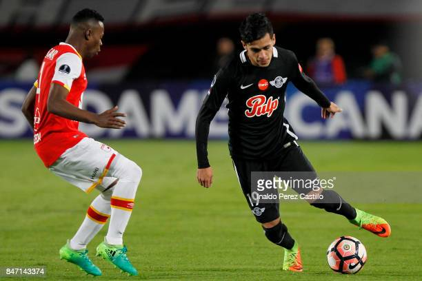 Baldomiro Pedraza of Santa Fe and Jose Medina of Libertad compete for the ball during a second leg match between Independiente Santa Fe and Libertad...