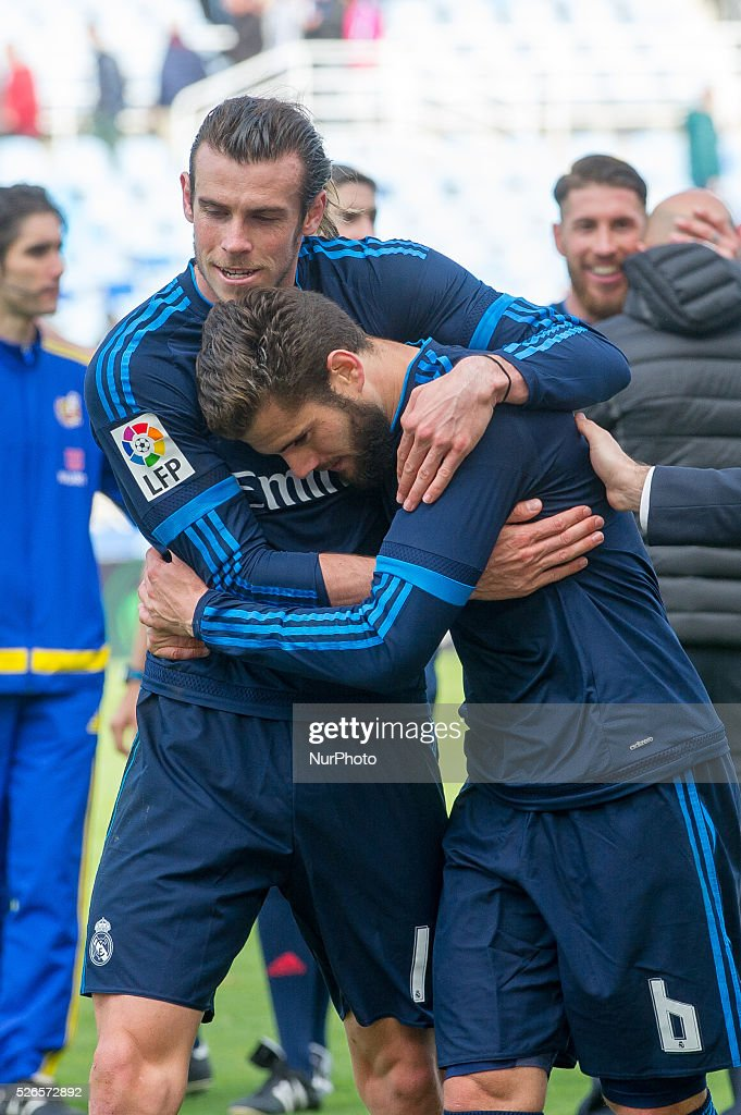 Bale and Nacho of Real Madrid reacts during the Spanish league football match between Real Sociedad and Real Madrid at the Anoeta Stadium in San Sebastian on April 30, 2016