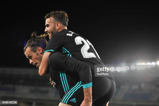 Bale of Real Madrid celebrates with teammates after scoring during the Spanish league football match between Real Sociedad and Real Madrid at the...