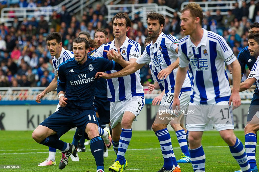 Bale of Real Madrid duels for the ball with Mikel Gonzalez Xabi Prieto and Zurutuza of Real Sociedad during the Spanish league football match between...