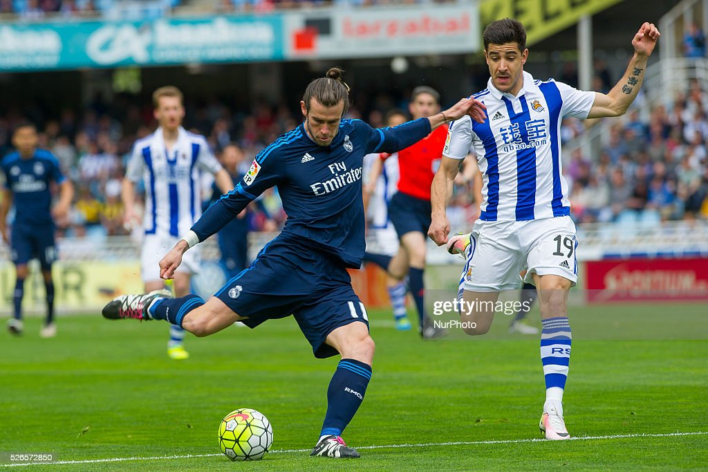 Bale of Real Madrid duels for the ball with Yuri of Real Sociedad during the Spanish league football match between Real Sociedad and Real Madrid at the Anoeta Stadium in San Sebastian on April 30, 2016