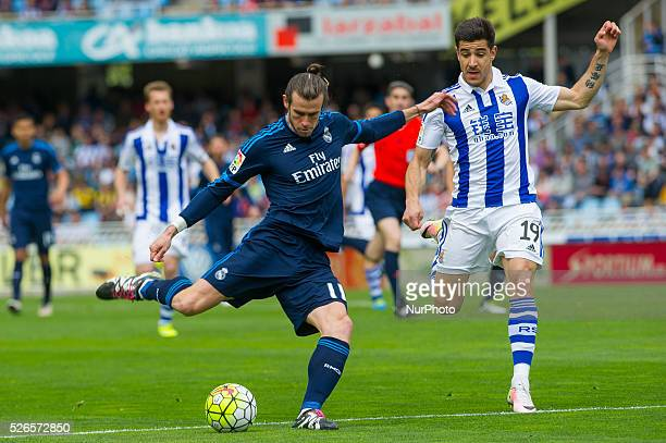 Bale of Real Madrid duels for the ball with Yuri of Real Sociedad during the Spanish league football match between Real Sociedad and Real Madrid at...
