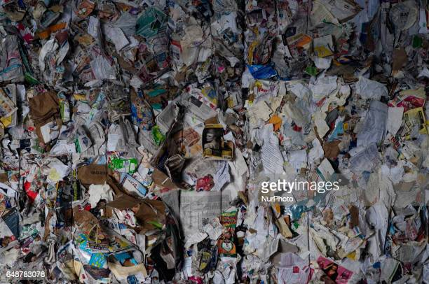 Bales of cardboard paper and plastics are stacked up high at the end of the process at the Materials Recovery Facility in South Philadelphia PA on...