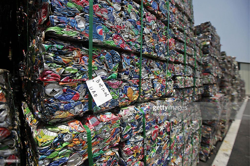 Bales of crushed aluminum cans sit stacked at the Novelis Inc. production facility in Yeongju, South Korea, on Thursday, May 23, 2013. Novelis Inc. plans to boost research and development staff by 40 percent as the biggest supplier of flat-rolled aluminum products to global carmakers seeks to increase recycled content in products used in cans and vehicles. Photographer: Woohae Cho/Bloomberg via Getty Images