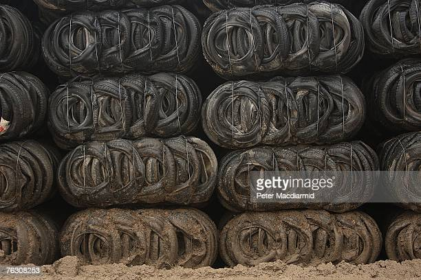 Bales of mud splashed tyres wait to used as a drainage layer when the ground is covered over with clay and soil at the Shelford Landfill Recycling...