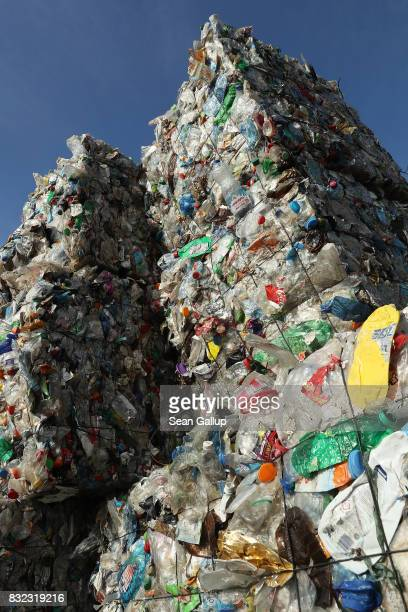 Bales of sorted plastic much of it from drin containers stand at the ALBA sorting center for the recycling of packaging materials on August 15 2017...