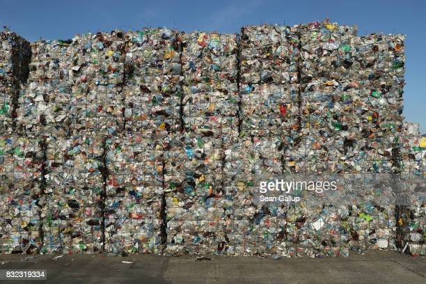 Bales of sorted plastic much of it from drinks containers stand at the ALBA sorting center for the recycling of packaging materials on August 15 2017...