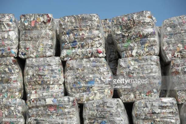 Bales of sorted trash stand at the ALBA sorting center for the recycling of packaging materials on August 15 2017 in Berlin Germany The facility...