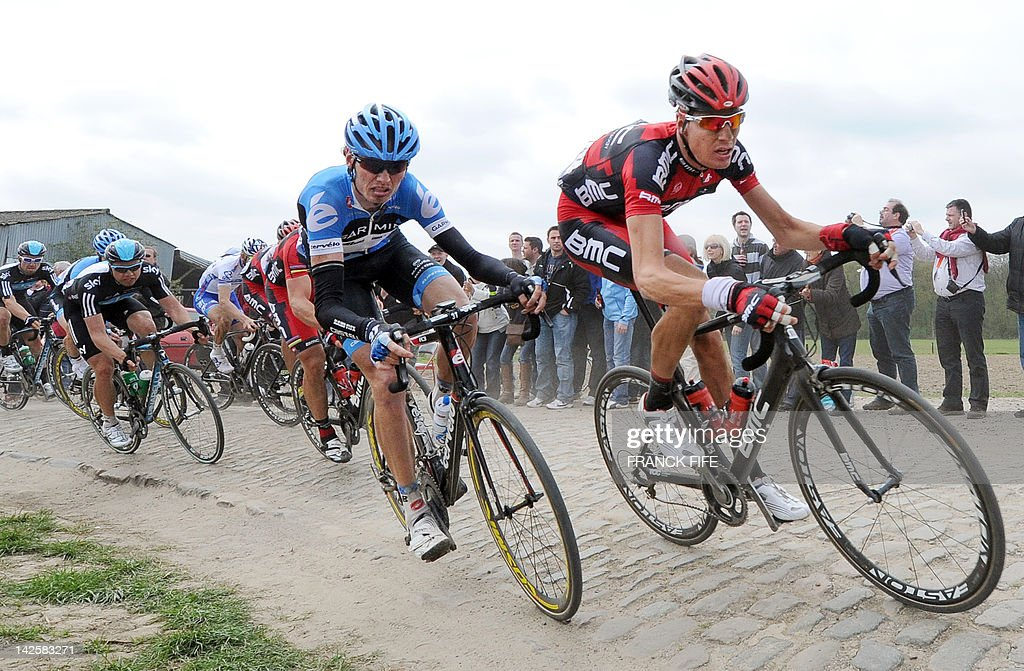 Balgium's Johan Vansummeren (L-Team Garmin - Barracuda) and Switzerland's Michael Schar (Team BMC) take a curve on a cobblestoned road during the 110th edition of the Paris-Roubaix one-day classic cycling race on April 8, 2012, in Roubaix, northern France. Belgian cyclist Tom Boonen, who had previously won in 2005, 2008 and 2009, equals the record of wins in Paris-Roubaix held by compatriot Roger De Vlaeminck. Boonen won the race ahead of French Sebatsien Turgot (Team Europcar) and Italy's Alessandro Ballan (Team BMC).