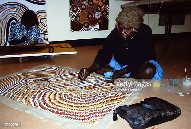 Balgo Community artist the late Mati Mudgedell working on a dot painting at the Warlayirti Culture Centre in the northwest desert region of Western...