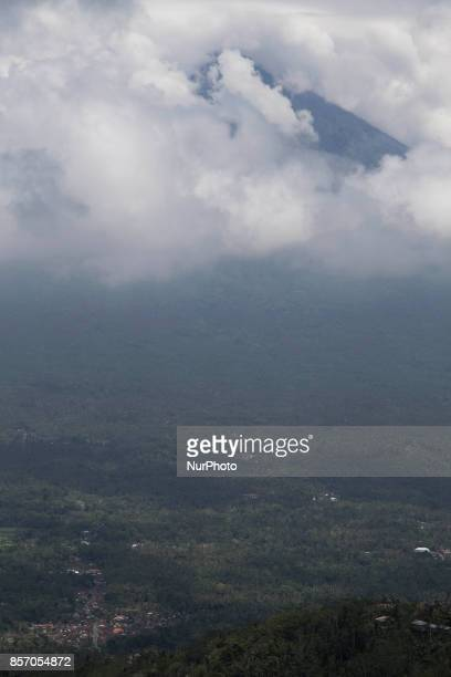 View of Moung Agung cover with cloud at a Temple in Bali Mount Agung statust still on level warning and people on the danger zone were still on...